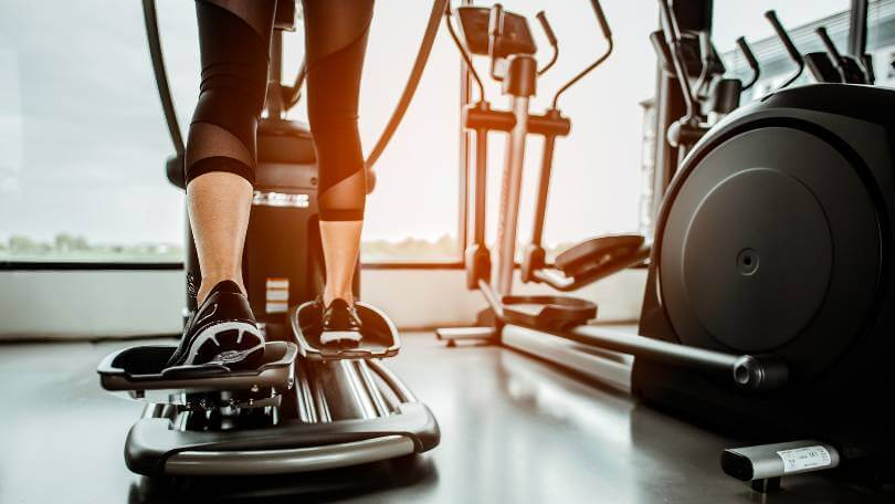 people working out on an elliptical trainer