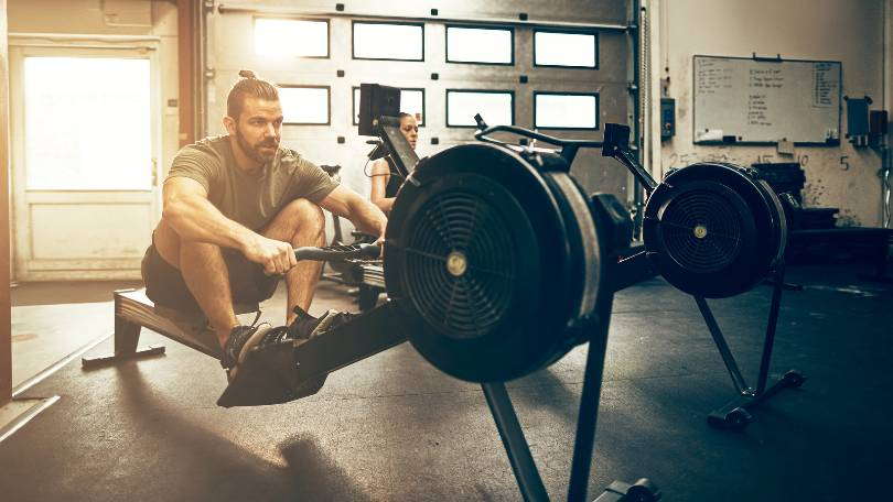Man on Rowing Machine at the Gym