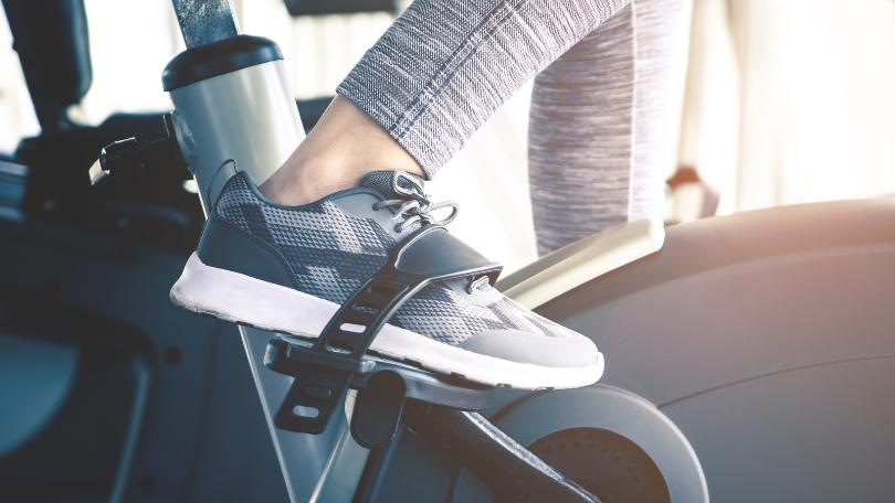 Woman feet is cycling on JOROTO X1S