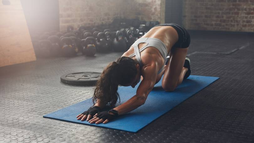 Young Woman Doing Exercise on HIIT Mat