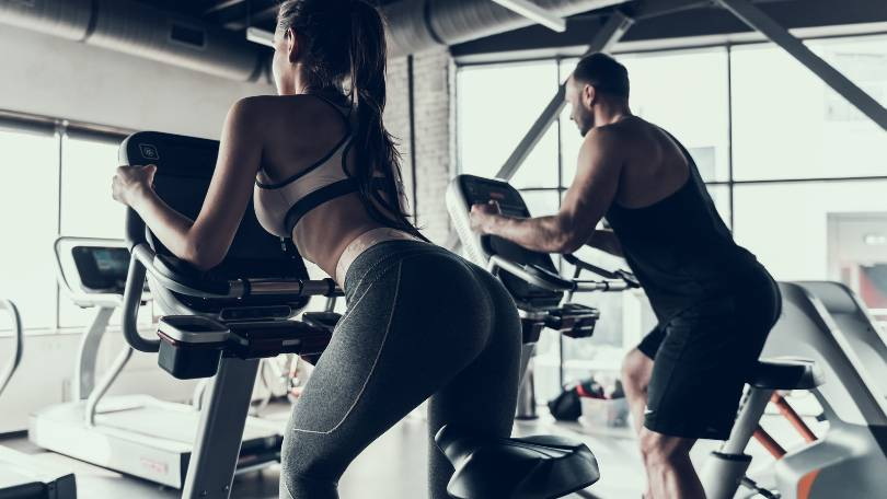 Couple Riding Exercise Bike