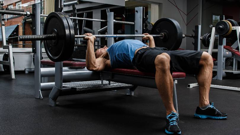 Man doing bench press on weight bench that has 1000 lb capacity