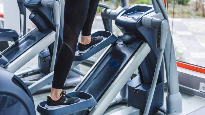 Woman working out on an elliptical machine under 600