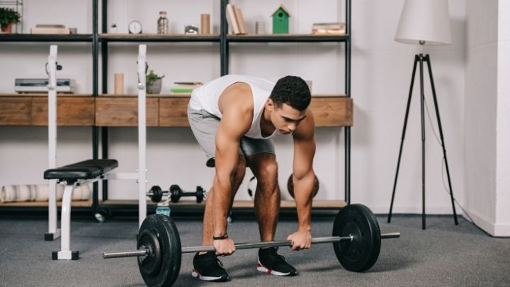 men doing strength workout in home gym